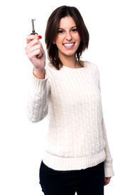 Woman Holding Up A House Key