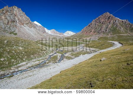 Mountain road along river. Tien Shan