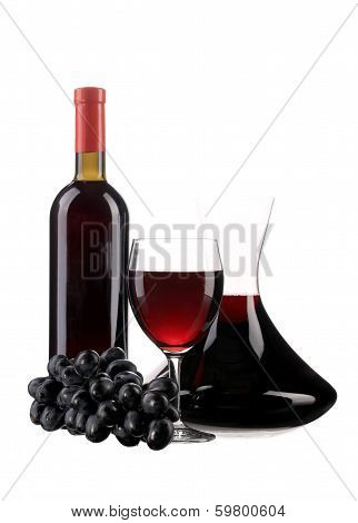 Decanter botle and glass with red wine