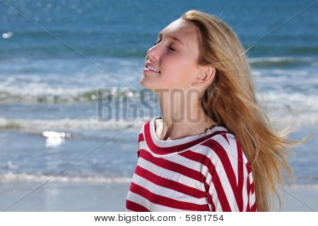Beautiful Girl Relaxing On The Beach
