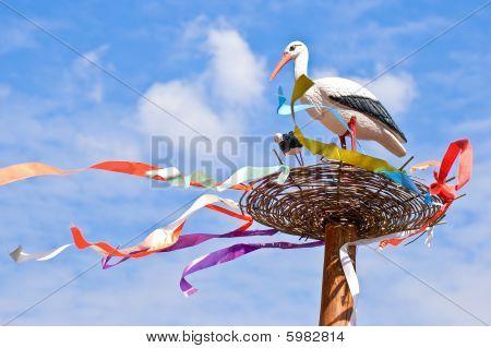 Storks Family In A Nest