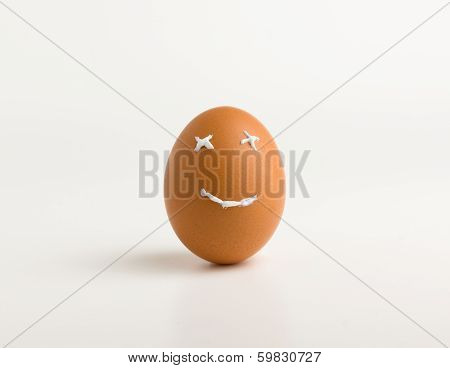 egg with a smile from a toothpaste on a white background poster