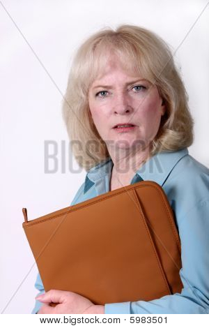 Older Businesswoman With An Irritated Facial Expression