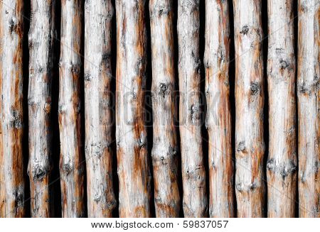 Background pattern from wooden poles.
