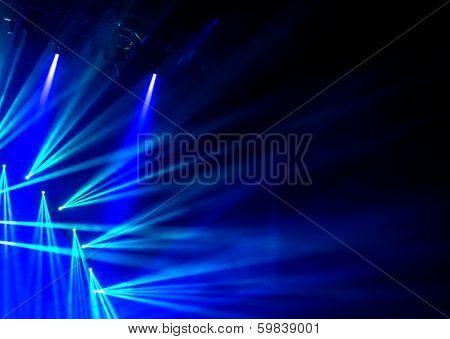 Blue stage light, abstract background, illuminated dance club, night performance, laser illumination, luxury rock concert projector