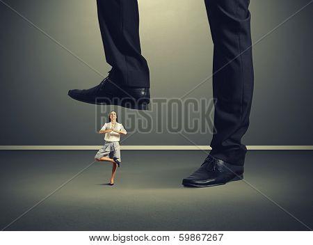 calm young woman under big leg his boss