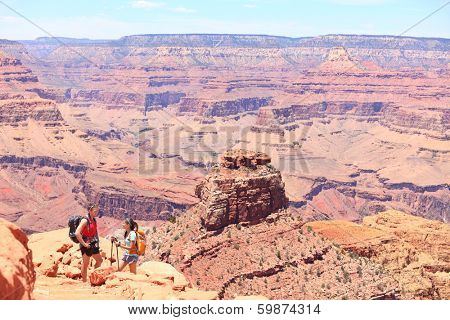Grand Canyon hiking people. Hiker couple enjoying hike and view on South Kaibab Trail, south rim of Grand Canyon, Arizona, USA.