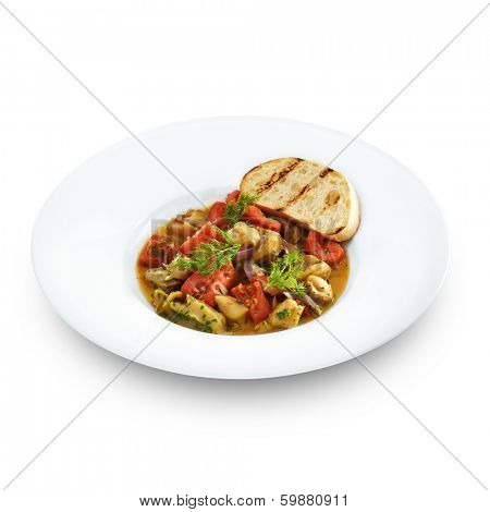 Delicious healthy backed rapana meat served with tomatoes and sweet onion in tomato sauce with toasted bread. Gourmet sea food isolated on white.