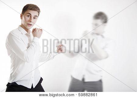 Shot Of Fighting Businessman.