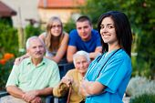 Confident and kind doctor welcoming the family members of the elderly patient. poster