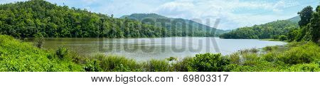 Panorama Landscape Of Green Lake With Mountain