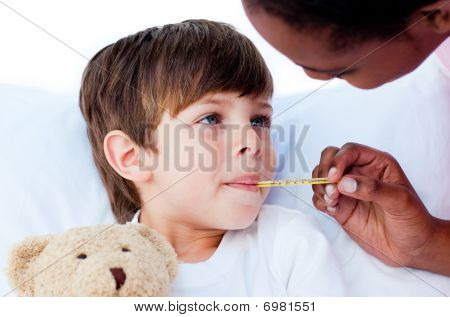 Close-up Of A Doctor Taking Child's Temperature
