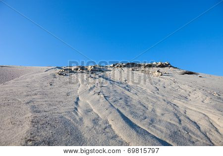 Gray Sand Dunes And The Blue Sky