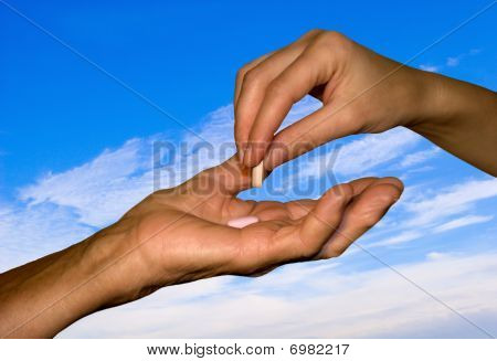 hand of old woman and and daughter with medicament
