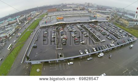 MOSCOW, RUSSIA - NOVEMBER 24, 2013: Parking near the Shopping Center Mall Gallery and Auchan hypermarket. Shopping Center opened July 28, 2005