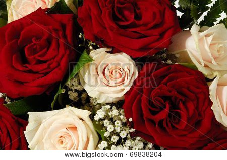 Flower bouquet of red and pink roses.