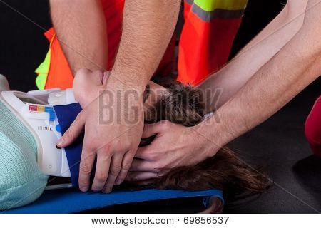 Paramedics Using Cervical Collar
