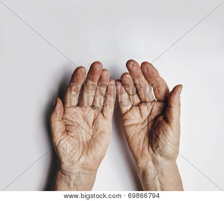 Pleading Hands Of Old Woman