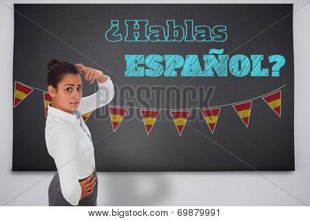 Worried businesswoman against black chalkboard, Do you speak Spanish?