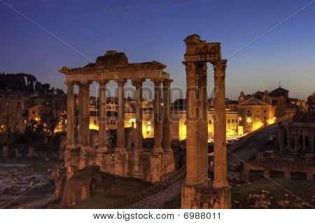 Blue hour at the Forum Romanum with temple of Saturn and of Vespasian and Titus Rome Italy poster
