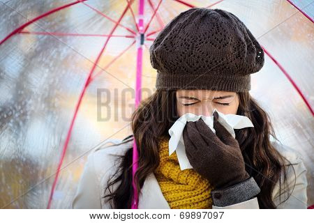 Woman Coughing And Blowing Her Nose In Autumn