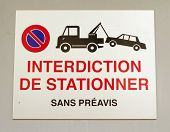 Close up on french vehicles towing sign on a wall poster