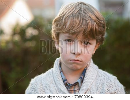 Sad Little Boy Looking At Camera
