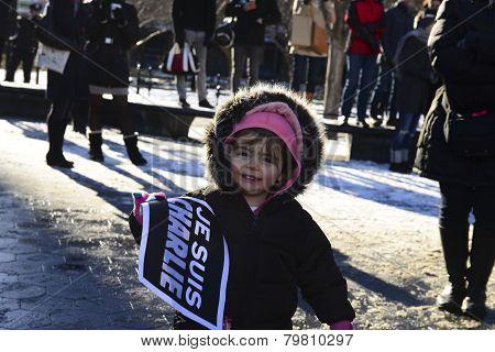 Toddler holding Je Suis Charlie sign