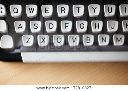 Typewriter qwerty keys on wooden desk
