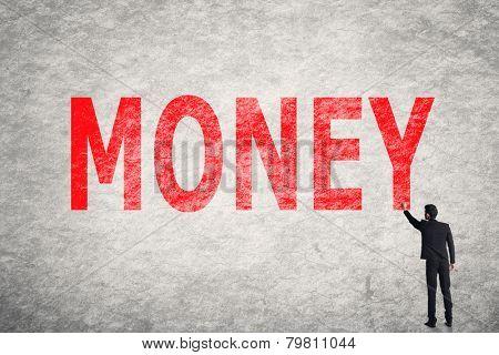 Asian businessman write text on wall, Money