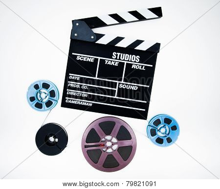 Clapper And 8Mm Different Reels Isolated On White Background