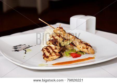 Lamb Kebab On White Plate With Cruet