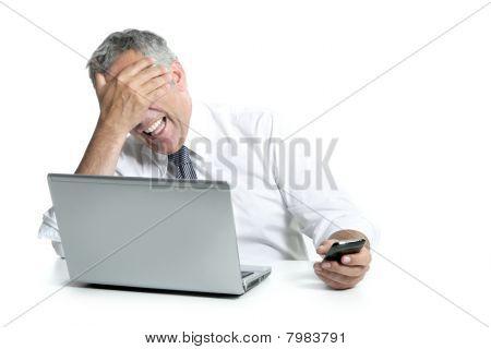 Laughing Senior Businessman Computer Phone Gesture