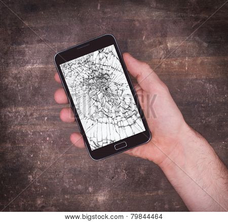 Hand Holding A Mobile Phone With A Broken Screen