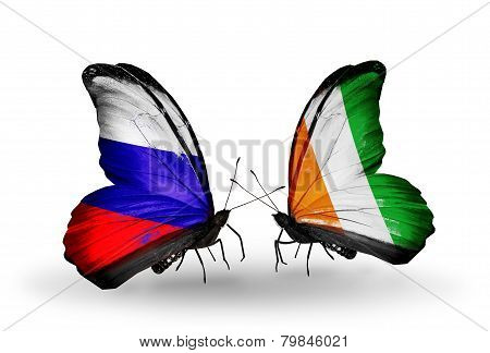 Two Butterflies With Flags On Wings As Symbol Of Relations Russia And Cote Divoire