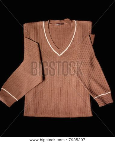 Brown Wool Jumper Cloth Isolated At Black Background
