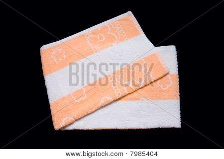 Towel Washcloth Isolated At Black Background