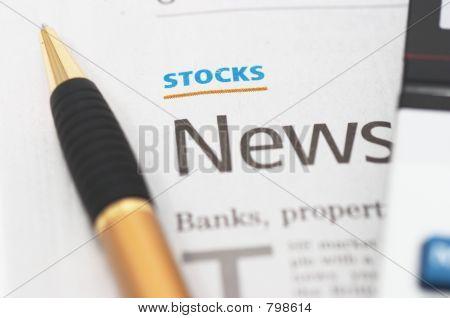 Stocks News, pen, calculator, banks, property headlines