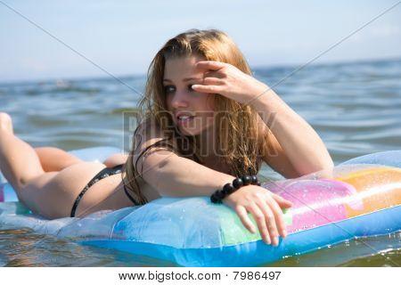 Beautiful girl swimming on in  baltic sea
