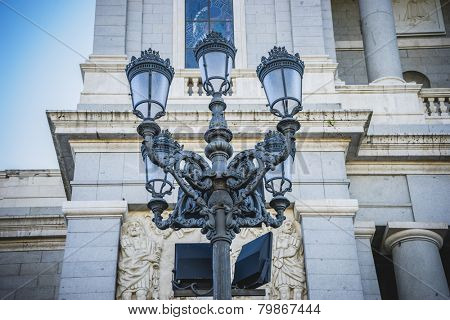 Old street lamp, Almudena Cathedral, located in the area of the Habsburgs, classical architecture