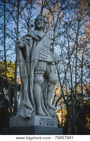 Gardens with sculptures, oldest street in the capital of Spain, the city of Madrid