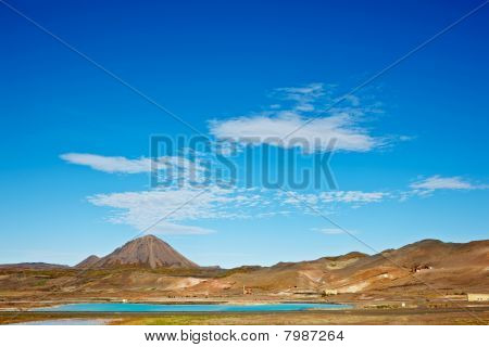 Beautiful Clouds Over The Bjarnarflag Mountain And Diatomite Pla