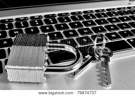 Modern Laptop With Closeup Of Lock And Keys