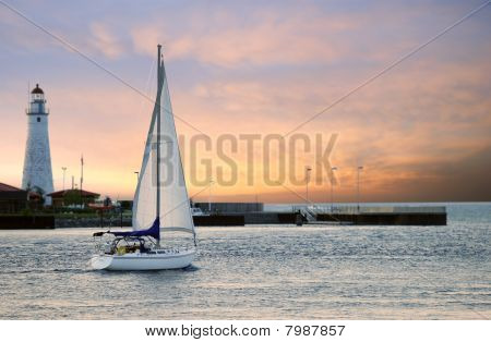 sailboat leaving marina