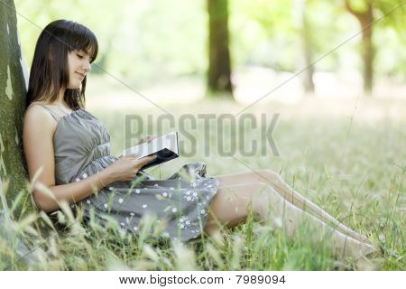 Girl Reading In Nature