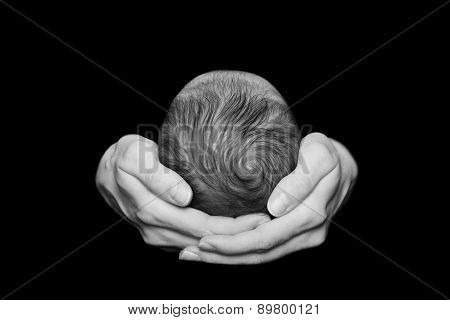 Newborn baby in the comfort and protection of his mothers arms