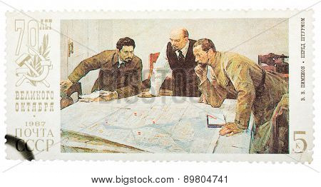 Stamp printed in Russia shows Lenin planning strategy with two g