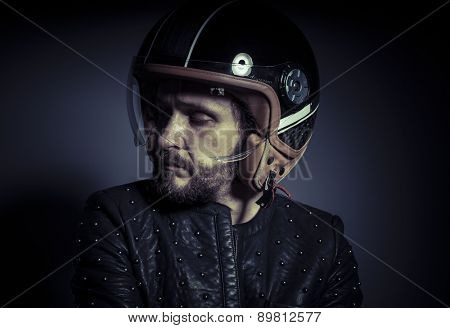 Trip, biker with motorcycle helmet and black leather jacket, metal studs
