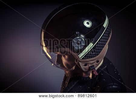 biker with motorcycle helmet and black leather jacket, metal studs