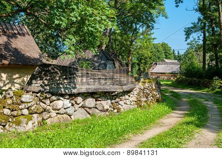 Mossy stone fence and old boat as decoration. Koguva village Saaremaa island Estonia Europe poster